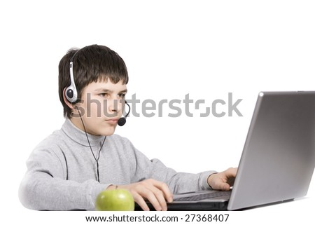 young boy siting with notebook and green apple isolated on white - stock photo
