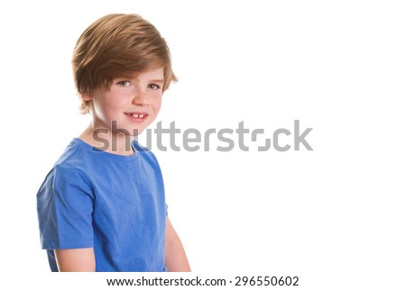 Young boy sitting and smiling at the camera with lots of copy space.