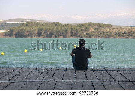 Young boy sitting in a pier