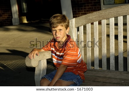Young Boy SItting on a Bench