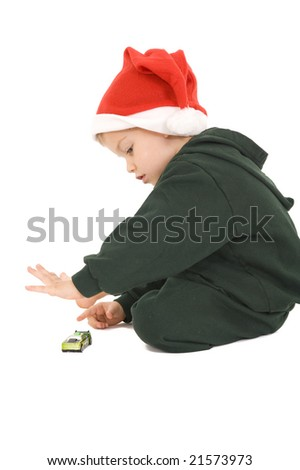 Young boy sitting playing with a small car. Isolated on white.