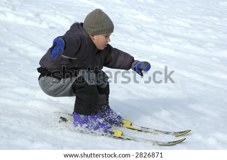 Young boy skiing cerefully down