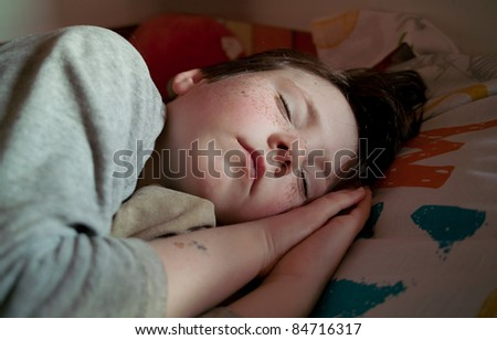 young boy sleeping in his room
