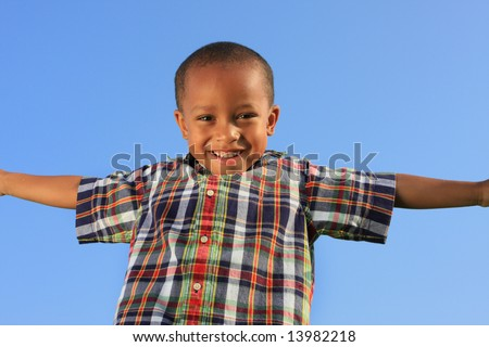Young Boy Smiling and Spreading His Arms - stock photo