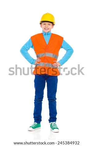 Young boy standing in yellow hard hat and orange reflective vest. Full length studio shot isolated on white. - stock photo