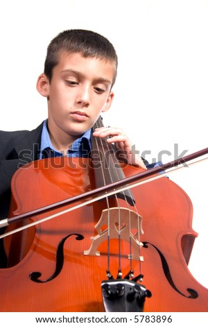 Young boy student practicing playing musical instrument Cello - stock photo