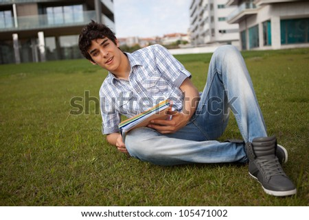 Young boy studying at the park - stock photo