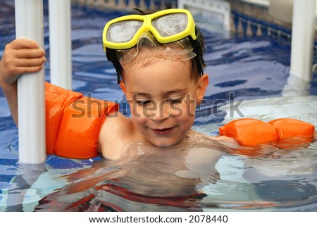 Young boy swimming - stock photo