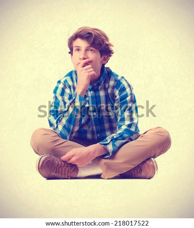 young boy thinking - stock photo