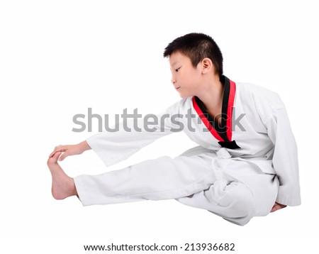 Young boy training taekwondo action isolated - stock photo