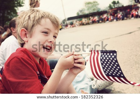 Young boy watching Holiday parade - stock photo