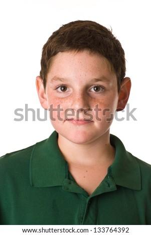 Young boy wearing a green polo shirt - stock photo