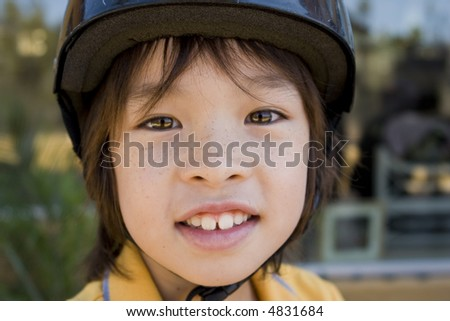 Young boy wearing a helmet - stock photo