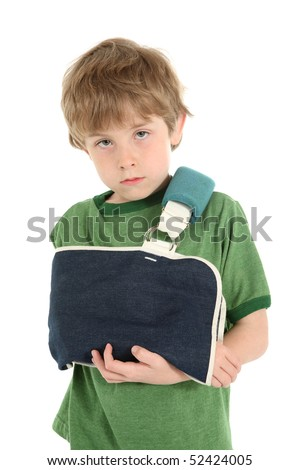Young boy wearing a sling on his arm - stock photo