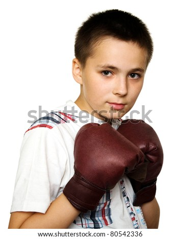Young boy wearing brown boxing gloves - stock photo