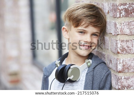 Young boy wearing headphones, close up  - stock photo
