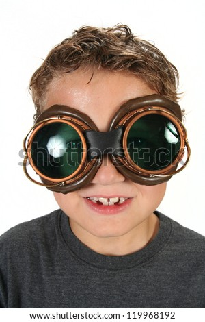 Young boy wearing steam punk goggles