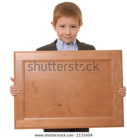 Young boy wearing suit holding blank wooden plaque