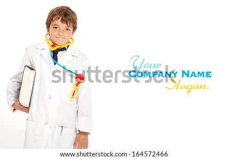 Young boy with a doctors uniform and toy instruments  - stock photo