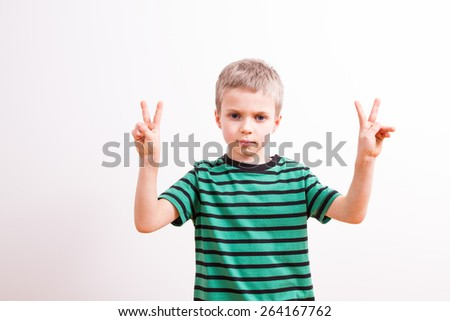 Young boy with a gesture  - stock photo
