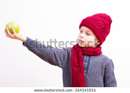 Young boy with a green apple - stock photo