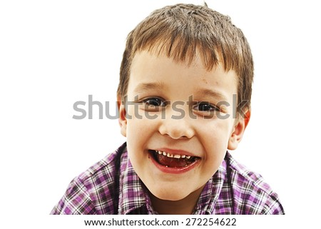 Young boy with a mouth full of chocolate biscuit. Isolated on white background. - stock photo