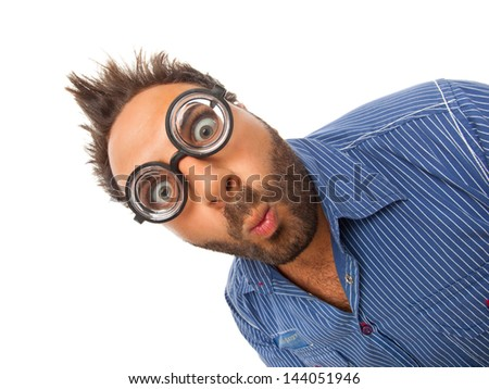 Young boy with a surprised expression with eye glasses - stock photo