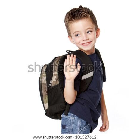 Young boy with backback waving goodbye - stock photo
