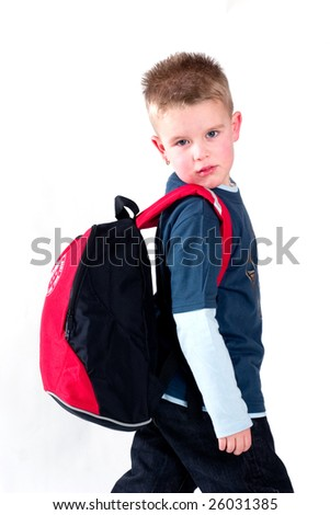 young boy with backpack on his back going to school - stock photo