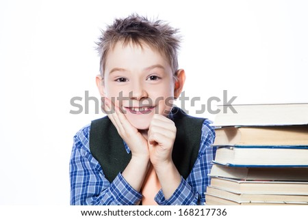Young boy with books on the white background - stock photo