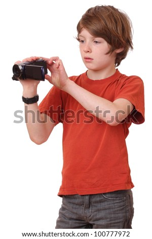 Young boy with camcorder on white background - stock photo
