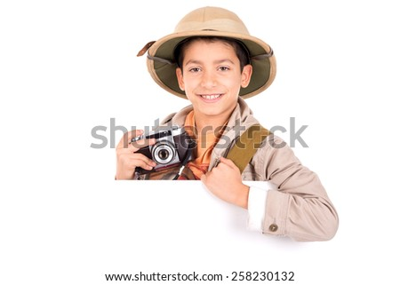 Young boy with camera playing Safari isolated in white - stock photo