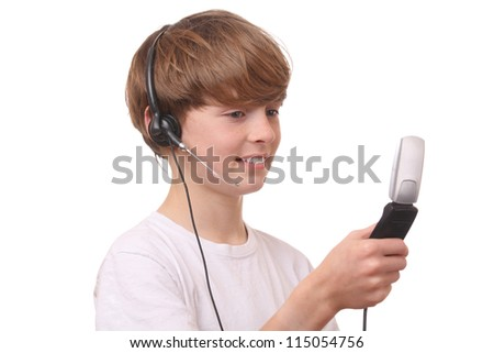 Young boy with cell phone and headset on white background