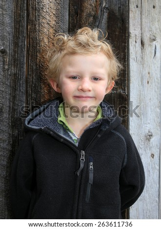 Young boy with curly hair. - stock photo