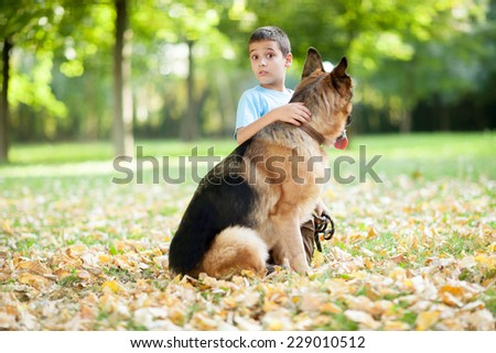 young boy with dog in park