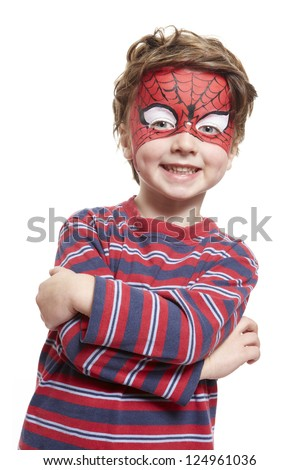 Young boy with face painting spiderman smiling on white background