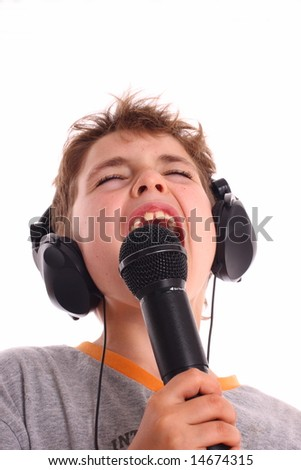 Young Boy with Headphone and microphone singing