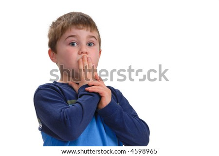 "Young boy with his hand on his mouth, signifying ""Speak No Evil"",  isolated on white with copy space"