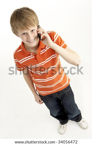 Young Boy With Mobile Phone - stock photo
