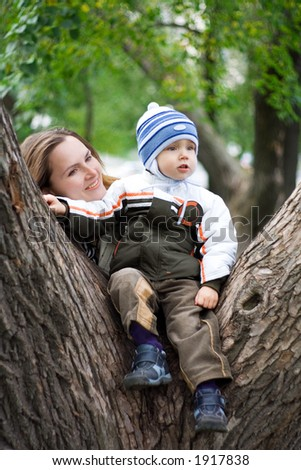 Young boy with mother in park. 4 - stock photo