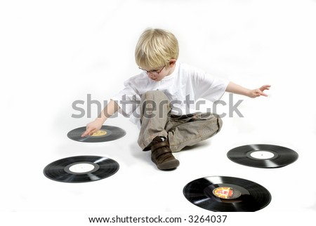 Young boy with old black vinyl - stock photo
