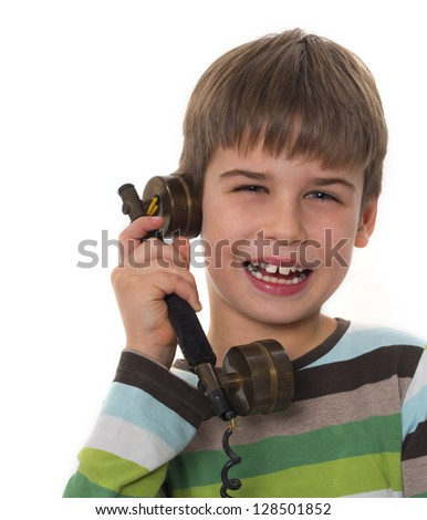 young boy with old vintage phone - stock photo