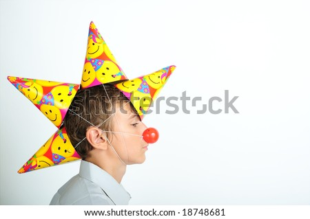 Young boy with party horn and clown noses - stock photo