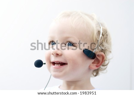 Young boy with phone headset - stock photo