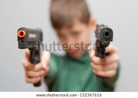 Young boy with plastic pistol