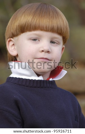 Young boy with red hair portrait.