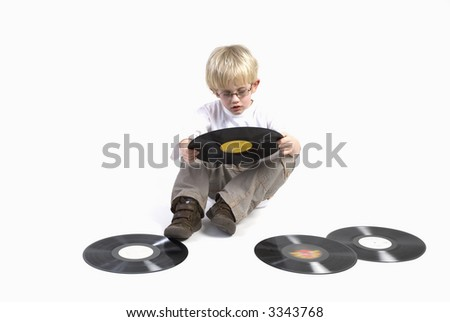 young boy with retro black vinyl to look - stock photo