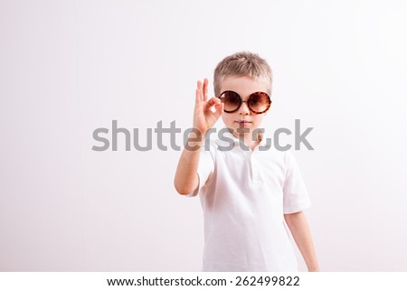Young boy with sunglasses - stock photo