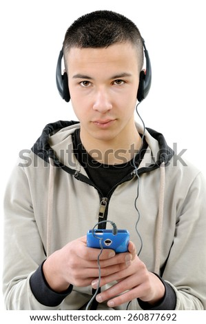 Young boy with the beard listening to music on headphones from a smartphone, photo on white background. - stock photo
