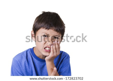 Young boy with tooth ache on white background